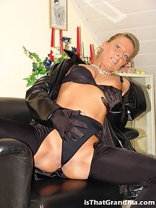 Horny grandma teasing us with her sexy leather clothes