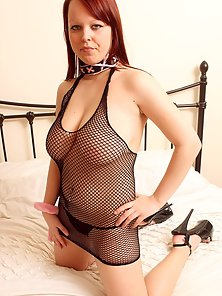 Adorable redhead with some gignatic tits shows naked body