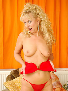 Naughty blonde anilos cougar gives herself a pussy wedgie with her red thong