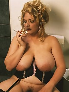 Smoking Mature Pale Blonde with Huge Tits in the Bathroom