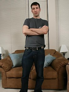 Tall brunette gay raymond strips jeans and jerks his big shaft
