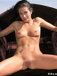 Randy Wright takes off her white skirt and poses naked outside