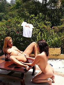 Pretty lesbian couple naked and fisting each other outdoors