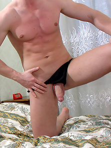Blond twink Andrey shows off his cock