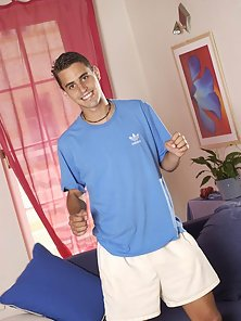 Cute Latino college student posing and playfully stripping his clothes in front of a live cam
