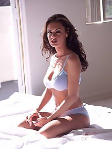 Crissy Moran spreading out naked on the bed