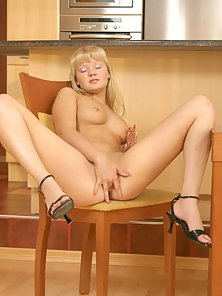 Lovely teen blonde plays with her pussy
