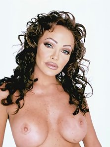 Curly and dark pornstar showing off boobs