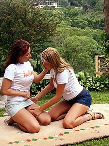 Two fist loving lesbians going at it hardcore while outdoors
