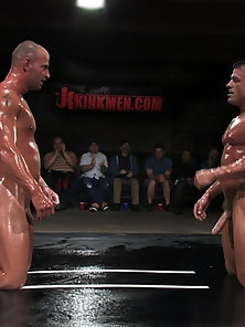 Muscled gladiators fight and fuck in front of a live audience.