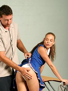 Horny cheerleader jerks a guy off while shes spanked