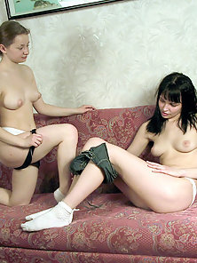 Two curious, slim babes strip and play with each other's pussies.