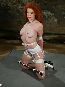 Statuesque redhead is bound and water tortured