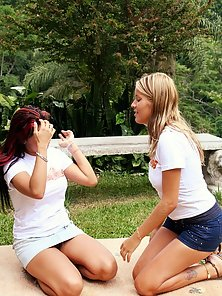 Horny college girls licking and fisting each other outdoors