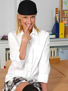 School girl Eve Faith lifts her uniform showing teen pussy