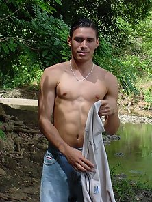 Nude latino with hot biceps sittion on a rock