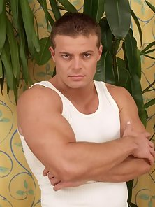 Beefy, muscular and hung like a horse, young hunk jerks off and pumps out load of cum.