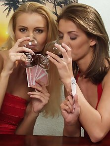 Blonde and brunette getting horny over wine and a card game