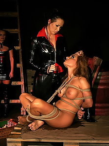 Sex and bondage in a dungeon with babes in latex