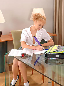 Prada pleasing her teen pussy with a large pen