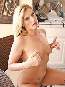 Desirable mature lady massages lotion over the circumference of her perky milf tits