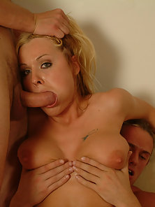 Horny babe massaging pussy while fucked by two guys