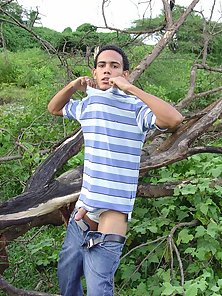 Latino masturbate by the old tree that fell in the ground