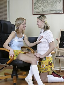 Two blonde teen lesbians get naughty on the couch