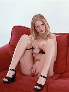 blonde chick showing off her tight little pussy