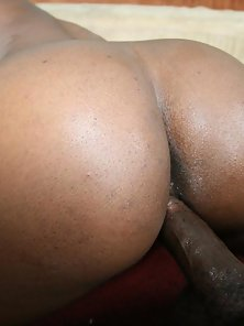 Busty ebony Milan shows off her big round ass