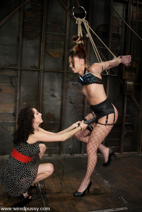 ... Satine Phoneix takes the cattle prod and a severe pussy caning ...