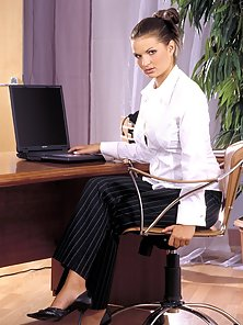 Sexy secretary fondling her own damp clit at the office