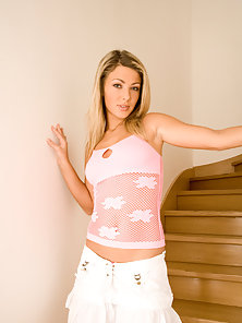 Pretty blonde chick plays with shaved pussy on stairs