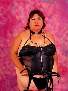 Dominatrix BBW in Black Suit Posing with Whip