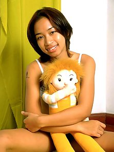 Young asian teen spreads her tight hairy twat
