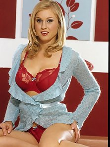 Busty blonde in red showing pussy
