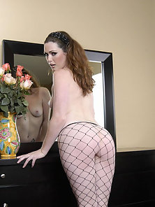 Aimee Sweet bent over the dresser in black fishnets