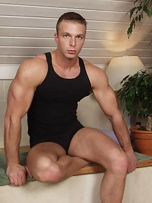 This big blonds studs muscles protrude from his sexy muscle shirt as does his bulging cock from his