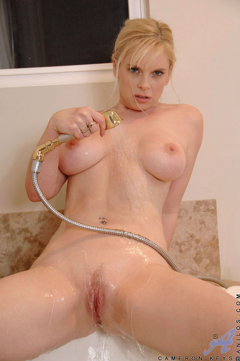 naughty cameron keys pours body wash on her mature breasts and