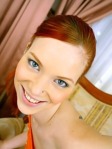 Teenage redhead loves getting a cumload in her open mouth
