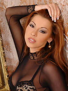 Klaudia loving her pussy with a large orange dildo
