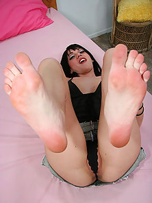 Short haired brunette slut wraps her painted toes around a thick hard dick