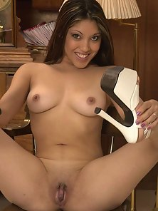 Busty Nautica opens her shaved pussy wide
