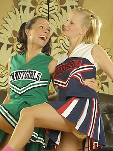 Hot cheerleaders strips and does steamy lesbian sex