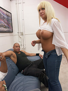 Busty babe enjoying in black threesome action