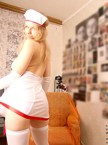 Sexy model wearing a nurse dress shows her bosoms and nice soft perky ass