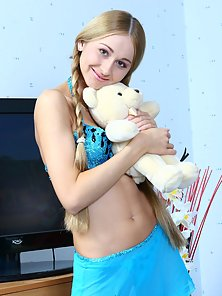 Cute teen with bear shows pussy in bedroom