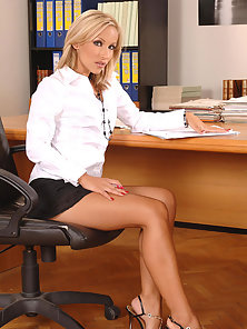 Two hot babes enjoy lesbian sex at the office