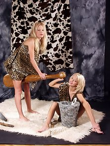 Blonde lesbians in cave girl costumes in action