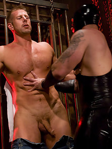 Dak Ramsey whips and fucks studly Mitch Colby in heavy bondage.